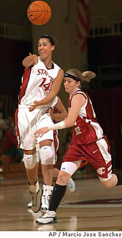 Stanford's Nicole Powell, left, passes the ball as Washington State's Stephanie Singer, right, chases in the first half on Saturday, Jan. 31, 2004 in Stanford, Calif. (AP Photo/Marcio Jose Sanchez) Photo: MARCIO JOSE SANCHEZ