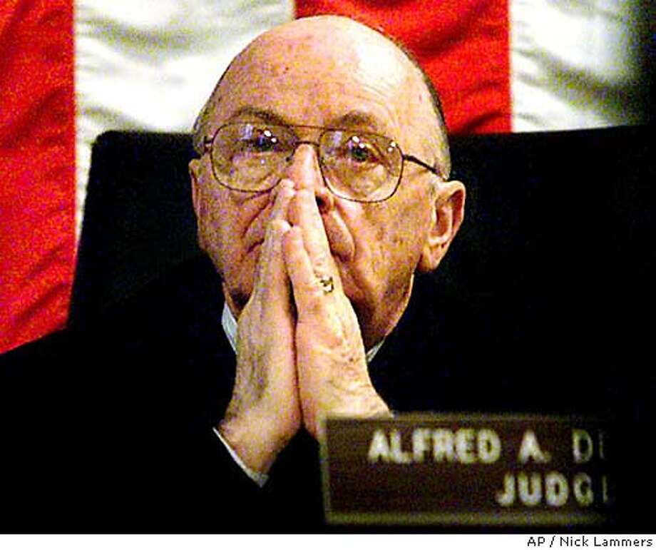 Retired Judge Alfred A. Delucchi, in this Monday, Oct. 23, 2000, file photo in Oakland, Calif., was selected Tuesday, Jan. 27, 2004, to preside over Scott Peterson's murder trial, a week after another judge was challenged by prosecutors. A trial judge for more than three decades, Delucchi, 73, retired in 1998 after serving in Alameda County for 15 years. He has been an active judge since his retirement and has continued to preside over trials. (AP Photo/Oakland Tribune, Nick Lammers) MAGS OUT MANDATORY CREDIT #######0421590239 Photo: NICK LAMMERS