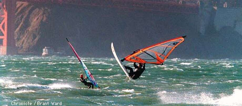WIND/08OCT97/MN/WARD--Windsurfers off Crissy Field had their hands full with strong winds Monday, although the winds attracted a large number of them. Some even went airborne as they negotiated the rough surf. By Brant Ward/Chronicle
