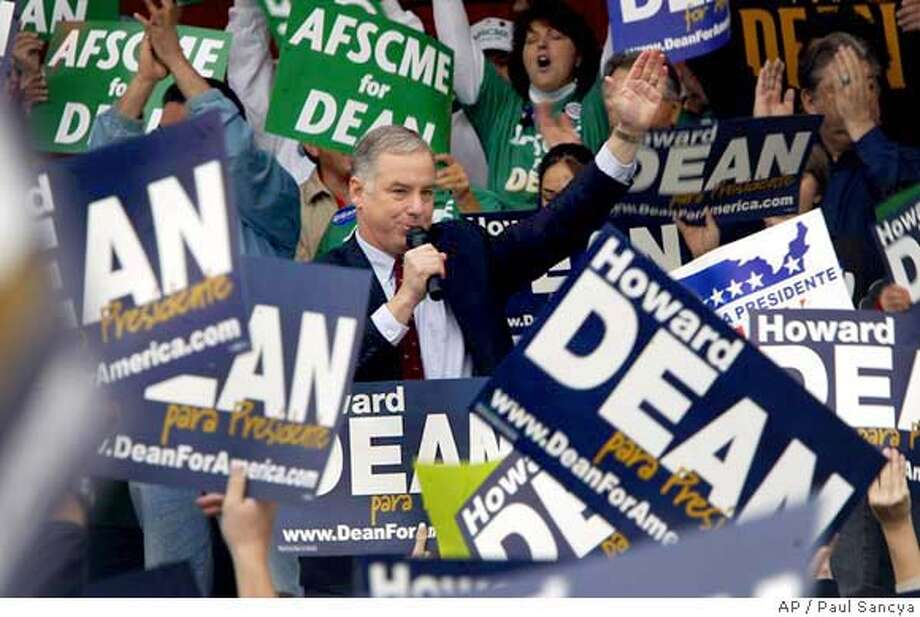 Democratic presidential hopeful former Vermont Gov. Howard Dean waves to supporters during a rally in Tucson, Ariz., Saturday, Jan. 31, 2004. (AP Photo/Paul Sancya) Photo: PAUL SANCYA