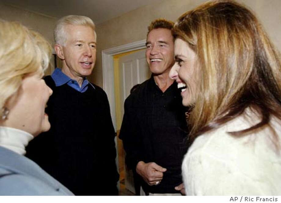 California Gov. Arnold Schwarzenegger, second from right, former governor Gray Davis, second from left, and their wives Sharon Davis, left, and Maria Shriver, right, chat during a Super Bowl party Sunday, Feb. 1, 2004, in the Encino section of Los Angeles. (AP Photo/Ric Francis) Photo: RIC FRANCIS