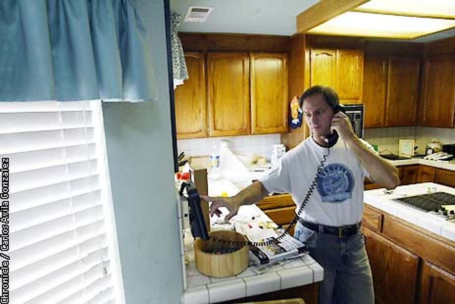 Sacramento resident, Michael Newdow, speaks to police from his home in Sacramento, Ca., on Wednesday, June 26, 2002, after the 9th Circuit Court of Appeals ruled on his lawsuit that saying the Pledge of Allegiance in schools violated the separation of church and state. Newdow had recieved several threatening phone calls in the wake of the decision, and just wanted to alert police to the calls.  (CARLOS AVILA GONZALEZ/SAN FRANCISCO CHRONICLE) Photo: CARLOS AVILA GONZALEZ