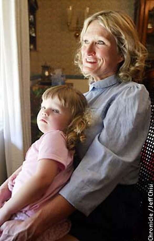 Alice Hoglan, 52, with niece Jillian Hoglan, at her brother Vaughn Hoglan's home in Saratoga on Wednesday afternoon. Hoglan will be presenting the trophy to this Saturday's San Francisco Fog gay rugby tournament named after her son Mark Bingham, who died in Flight 93 on September 11. She will also march with the Fog at Sunday's Gay Pride Parade. Photo by Jeff Chiu/The Chronicle Photo: Jeff Chiu