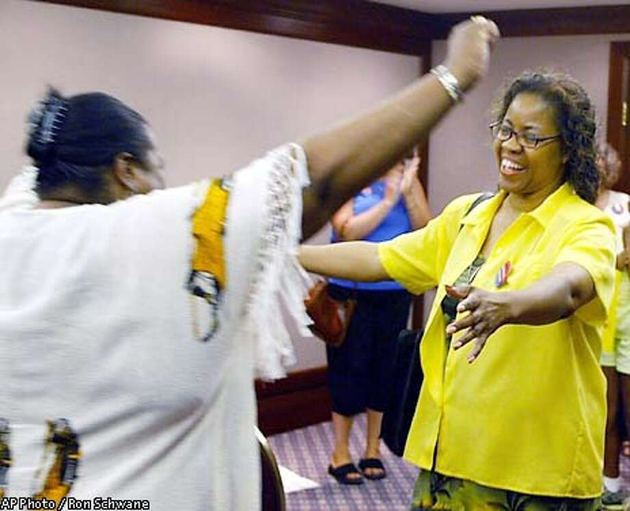 Roberta Kitchen, right, and Rosa-Linda Demore-Brown, executive director of the Cleveland Parents of School Choice, celebrate prior to a news conference in Cleveland, Thursday, June 27, 2002, after the U.S. Supreme Court ruled in favor of school voucher programs if they provide parents a choice among a range of religious and secular schools. The 5-4 ruling endorsed a 6-year-old pilot program in inner-city Cleveland that provides parents a tax-supported education stipend. (AP Photo/Ron Schwane) Photo: RON SCHWANE