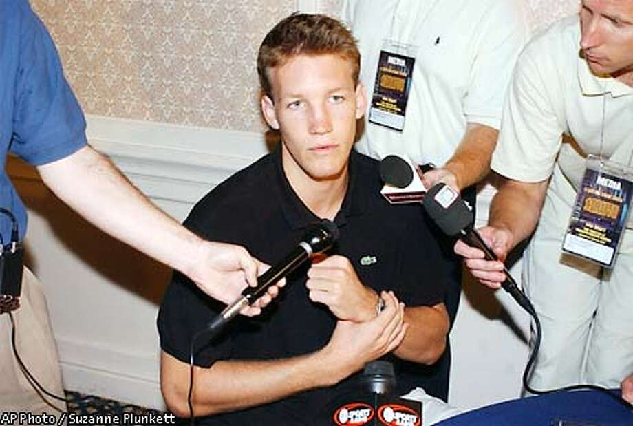 NBA Draft prospect Mike Dunleavy talks with reporters, Tuesday, June 25, 2002, in New York. Dunleavy is expected to be selected at the NBA Draft on Wednesday. (AP Photo/Suzanne Plunkett) Photo: SUZANNE PLUNKETT