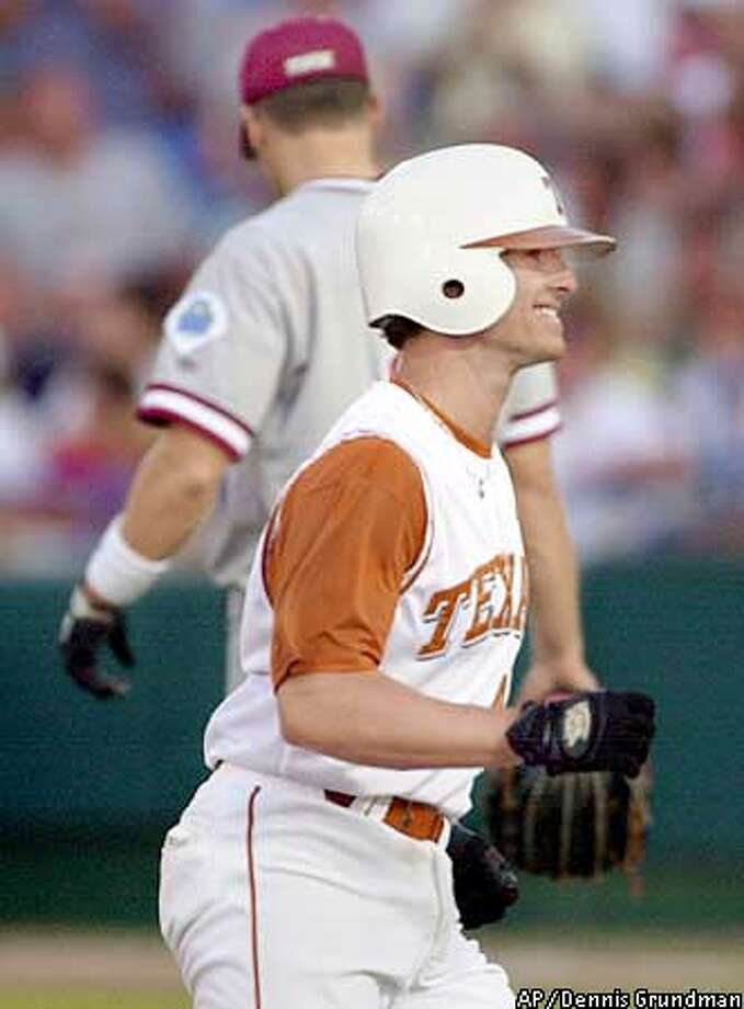 Texas designated hitter J.D. Reininger smiles as he rounds the bases after hitting a two-run home run in the fourth inning against Stanford in a College World Series game held in Omaha, Neb., Monday June 17, 2002.(AP Photo/Dennis Grundman) Photo: DENNIS GRUNDMAN