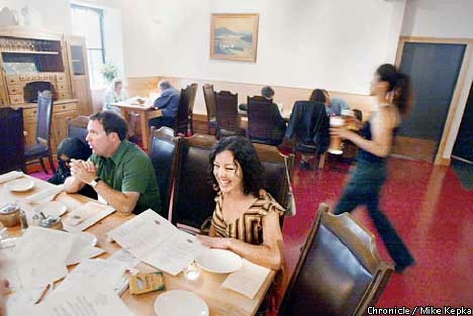Peter and Bernadette Holmes of Alameda try the newest restaurant in town, Speisekammer. BY MIKE KEPKA/THE CHRONICLE Photo: MIKE KEPKA