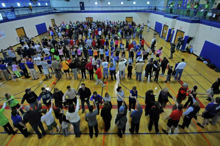 428 people set an unofficial world's record during the Fit as a Family Fist Bump at the Southern Saratoga YMCA, on Sunday Jan. 29, 2012 in Clifton Park, NY.  (Philip Kamrass / Times Union ) Photo: Philip Kamrass / 00016224A