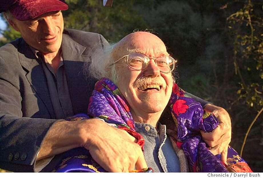 Ram Dass, 71, as his friend, Michael John, puts a blanket around over his shoulders outside Ram Dass' home. 1/22/04 in Woodside. DARRYL BUSH / The Chronicle Photo: DARRYL BUSH