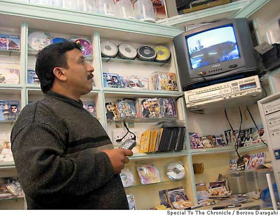 / for: Foreign slug: JIHAD_POP;  At Sabah Recordings, a popular cassette  shop in a Fallujah alleyway, owner Maher al-Ajrari  first denies he even sells al-Jenabi�s music. After an  hour of hemming and hawing, he admits the Jihad tapes  are his bestselling products. Jan. 3, 2004 PHOTO BY  DELPHINE MINOUI Borzou Daragahi / Special To The Chronicle Photo: Borzou Daragahi