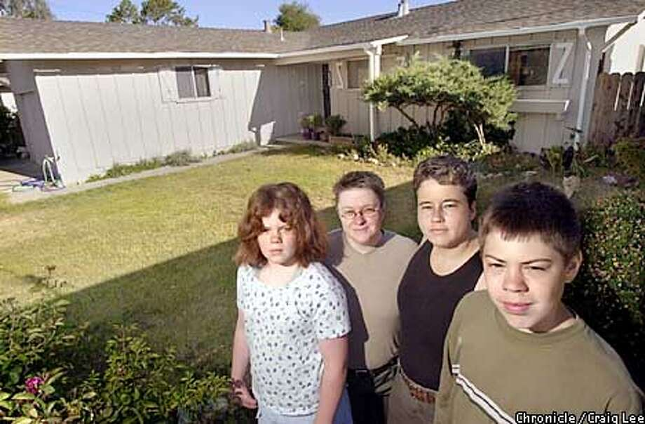 Photo of Elizabeth Gilliam(middle left), her partner, Stripe Demarest(middle right), and their children, Kathy Lee(far left), 11, and Lyle Lee(far right), 13. Story about people still being priced out of homes locally. Elizabeth and Stripe have a combined income of more than $100, 000 annually and still can't find a house they can afford. They are in front of their house they rent which they probably can't afford to buy either if it were for sale.  Photo by Craig Lee/San Francisco Chronicle Photo: CRAIG LEE