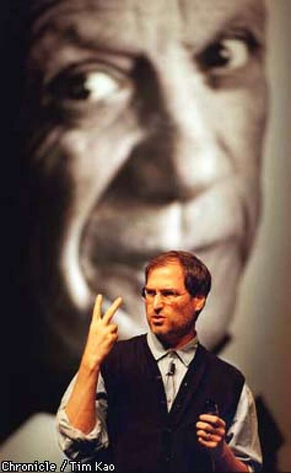 "=STEVE Jobs spoke at the Seybold publishing conference '97 in front of a giant poster of Pablo Picasso, featured in Apple's new ad campaign ""think different"". PHOTO BY TIM KAO/THE CHRONICLE Photo: TIM KAO"