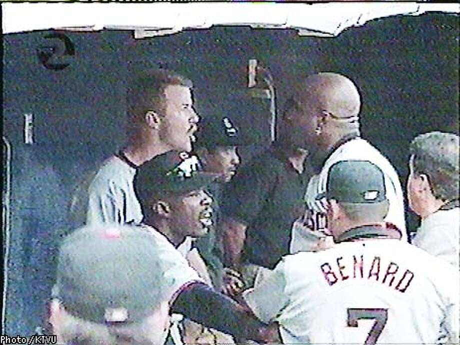 Jeff Kent and Barry Bonds get into it after the Padres scored five runs in the second inning; Bonds hit a three-run homer afterward. Photo courtesy of KTVU