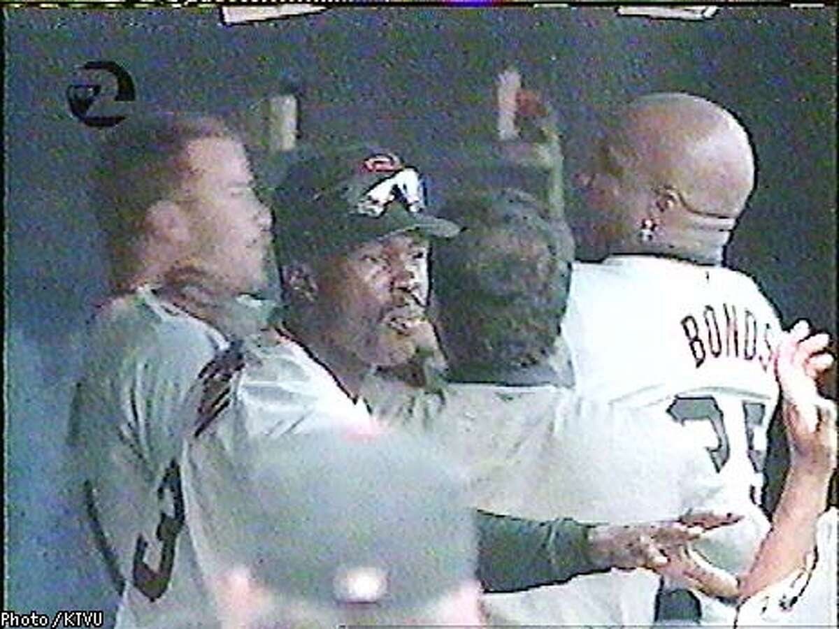 Barry Bonds appeared to shove teammate Jeff Kent during a tussle in the Giants' dugout during Tuesday night's game against San Diego. Trainer Stan Conte attempted to separate the pair. Photo courtesy of KTVU