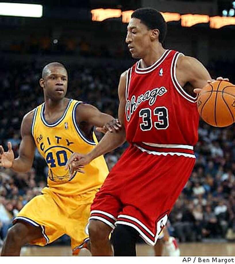 Golden State Warriors' Calbert Cheaney (40) guards Chicago Bulls' Scottie Pippen (33) in the first half Friday, Jan. 30, 2004, in Oakland, Calif. (AP Photo/Ben Margot) Photo: BEN MARGOT