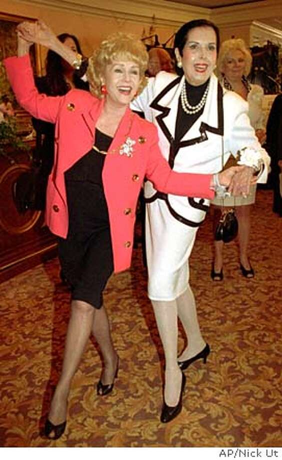 ** FILE ** Debbie Reynolds, left, and Ann Miller, dance together at the American Movie Classics Fourth Annual Film Preservation Festival at the Beverly Hills Hotel in Beverly Hills, Calif., in this June 12, 1996 file photo. Miller, the raven-haired, long-legged actress and dancer whose machine-gun taps won her stardom during the golden age of movie musicals, died Thursday, Jan. 21, 2004 of lung cancer. She was 81. (AP Photo/Nick Ut) Photo: NICK UT