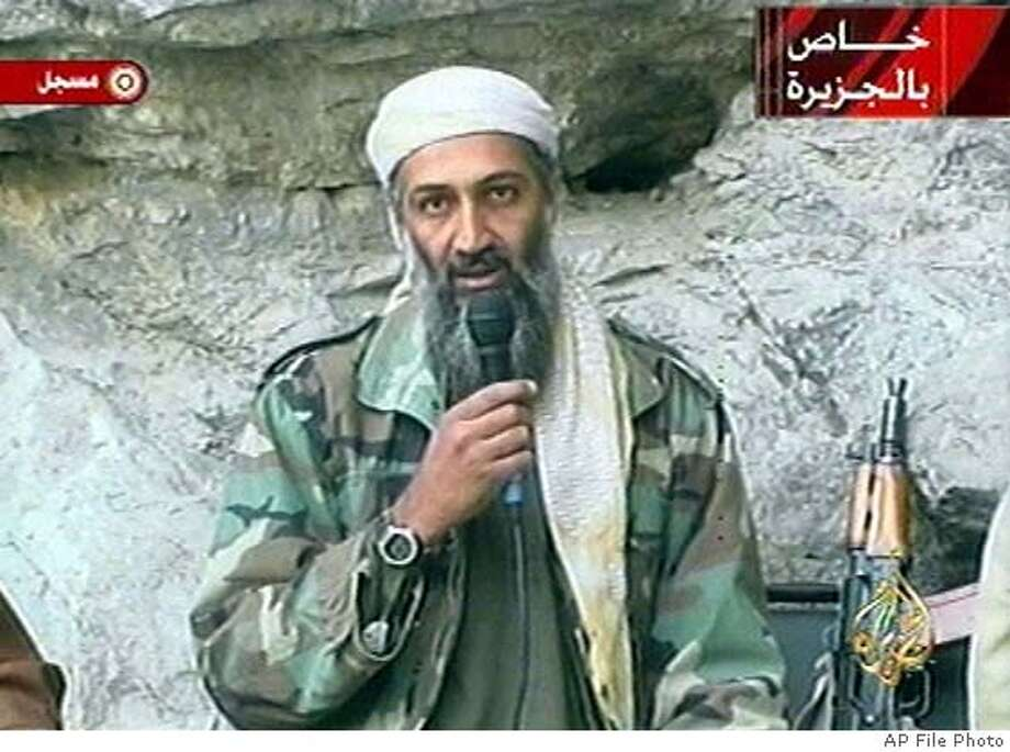 "ADVANCE FOR WEEKEND EDITIONS, MARCH 2-3 -- FILE-- Osama bin Laden is seen at an undisclosed location in this television image broadcast Sunday, Oct. 7, 2001. Graphic at top right reads ""Exclusive to Al-Jazeera."" At bottom right is the station's logo which reads ""Al-Jazeera."" At top left is ""recorded."" (AP Photo/FILE/Al Jazeera) CAT HFR 03-02-02 ADVANCE FOR WEEKEND EDITIONS, MARCH 2-3. IMAGE TAKEN FROM TELEVISION. OCT. 2, 2001 FILE PHOTO Insight#Insight#Chronicle#02/01/04#ALL#Advance##"