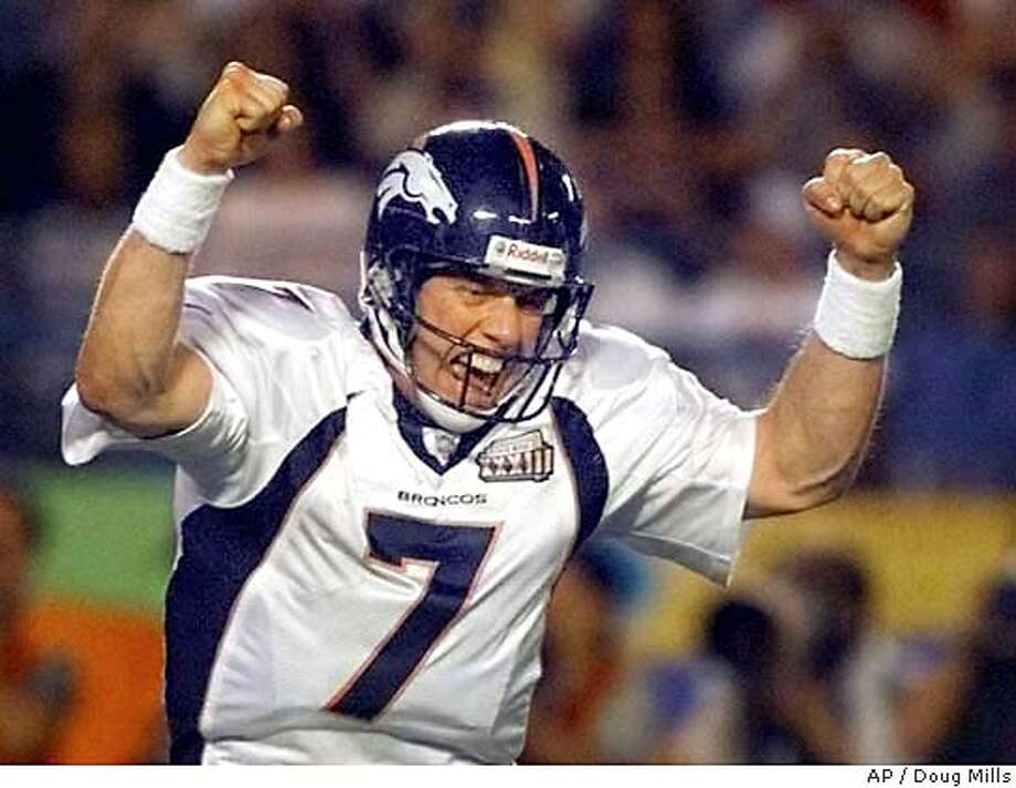 ** FILE ** Denver Broncos quarterback John Elway celebates a fourth quarter touchdown against the Atlanta Falcons in Super Bowl XXXIII in Miami, in this Jan. 31, 1999 photo. In his final game on Jan. 31, 1999, Elway led the Broncos to their second straight Super Bowl championship with a 34-19 win over Atlanta. On Saturday _ five years later to the day _ Elway will likely be voted into the Pro Football Hall of Fame in his first year of eligibility.(AP Photo/Doug Mills) A Jan. 31, 1999 file photo Photo: DOUG MILLS