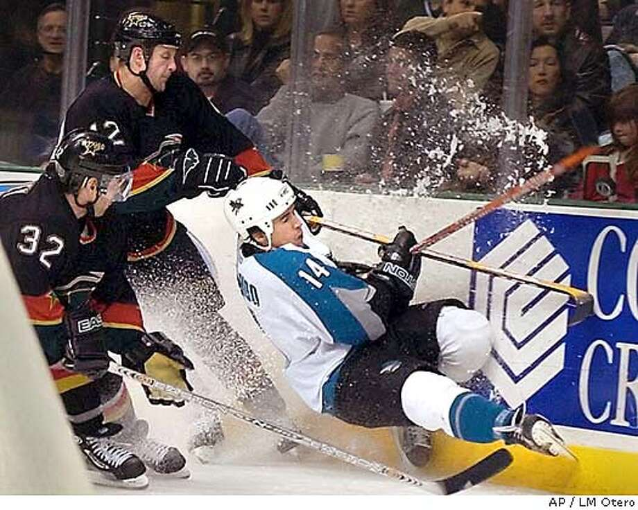 San Jose Sharks Jonathan Cheechoo (14) battles for the puck against Dallas Stars Don Sweeney (32) and Jon Klemm (42) during the second period in Dallas, Friday, Jan 30, 2004. (AP Photo/LM Otero) Photo: LM OTERO