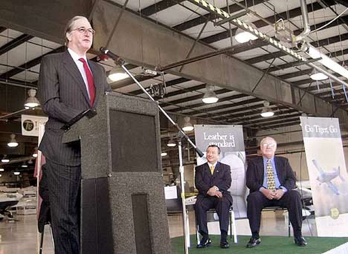 Sen. Jay Rockefeller, D-W. Va., talks at the rollout ceremony for the first three AG-5B built at the Eastern West Virginia Regional Airport in Martinsburg, W.Va., Monday, Dec. 3, 2001. Seated at center is Taiwan's Vice Ministerof Economics Chi-Ming Yiin, and at right representative John Sickles. Backed by a consortium of Taiwanese investors, the company has labored on the four-person single engine plane for nearly four years. (AP Photo/The Journal, Ron Agnir)