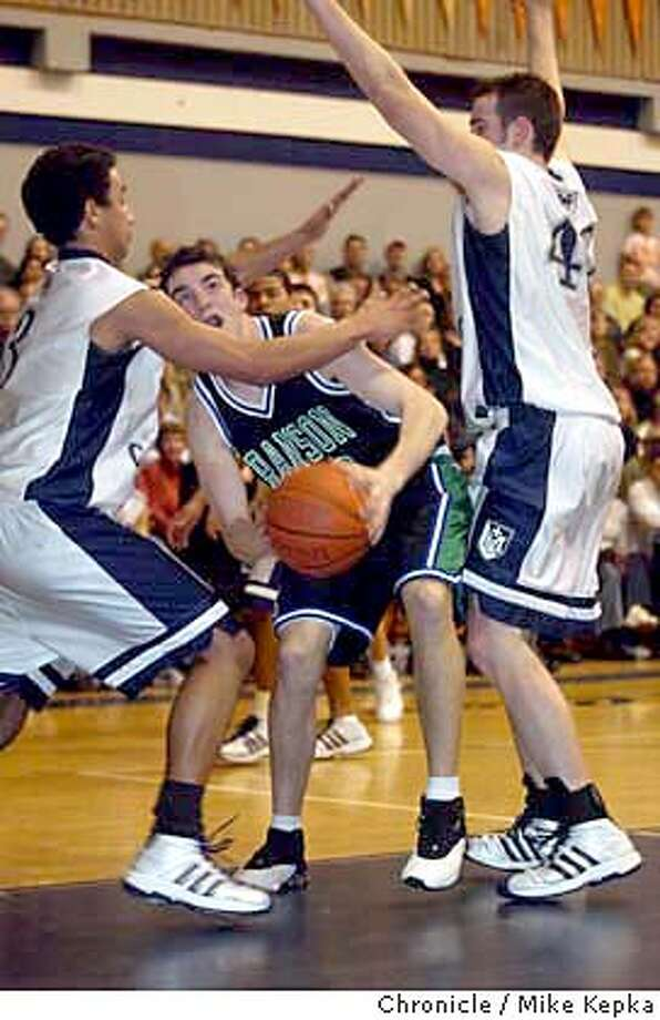 Branson's Peter Markun tries to get out from under Marin Catholic's Michael Turner and Preston Hoopes  Marin Catholic and Branson play at Marin Catholic.  Event on 1/30/04 in Kentfield. Mike Kepka / The Chronicle Photo: Mike Kepka
