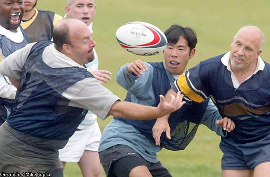 Stewart Bennett, Naoki Nitta and Peter DuBois fight for control of the ball during an S.F. Fog rugby team practice. Chronicle photo by Mike Kepka