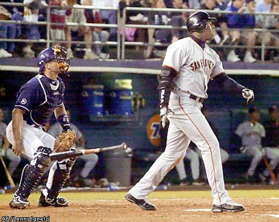 San Francisco Giants' Barry Bonds drops his bat in front of San Diego Padres catcher Tom Lampkin and watches the flight of his three-run home run in the seventh inning of their game Monday June 24, 2002 in San Diego. (AP Photo/Lenny Ignelzi) Photo: LENNY IGNELZI