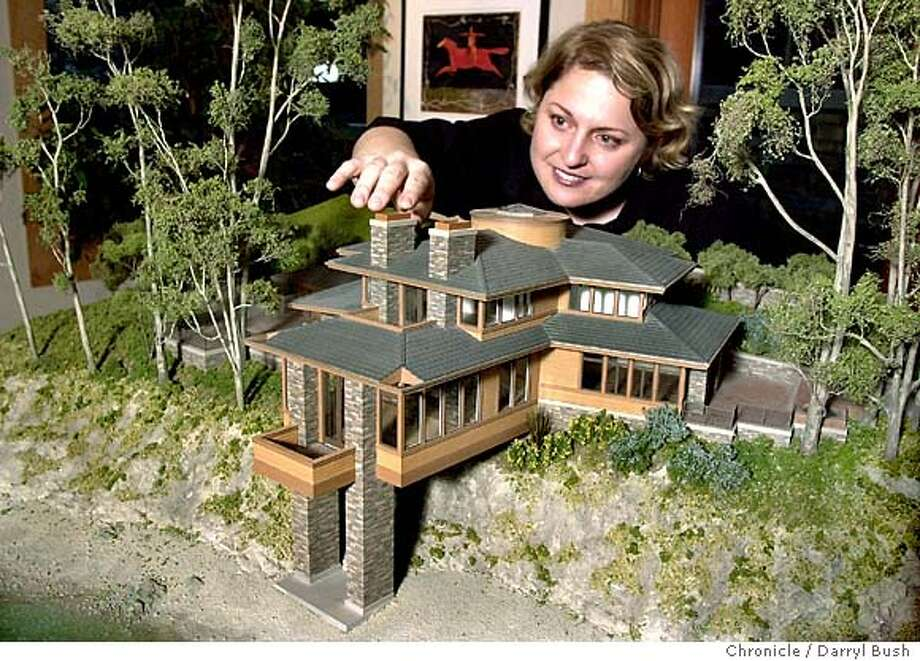 Lisa Gemmiti, model maker adjusts her model of the De Silva Hedgpeth house. 1/21/04 in Mill Valley. DARRYL BUSH / The Chronicle Photo: DARRYL BUSH