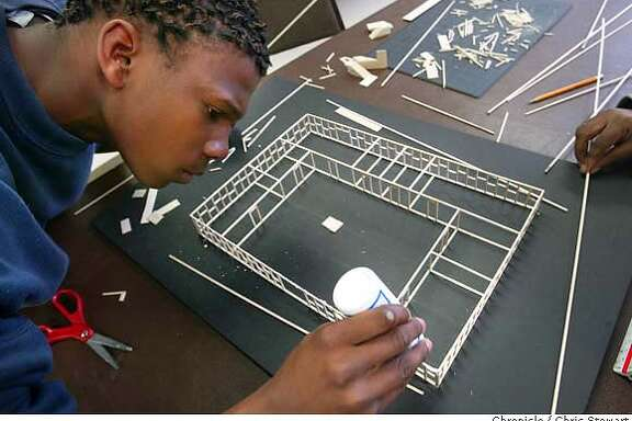 Event on 1/26/04 in San Leandro.  Quan Baker, 17, applies white glue to a wood architectural model. Baker is a former kid in trouble who now has a career in design. At-risk boys serving out their probations for non-violent crimes at Wilmont Sweeney Boys Camp in San Leandro are getting a second chance from Cornerstone Concilium, Inc., a San Francisco architecture firm that is teaching them how to scale, design and make models of buildings. Baker works as a teaching assistant in the program. Chris Stewart / The Chronicle