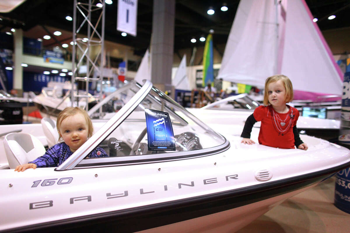 Kelly, 1, and Kim, 4, look for pirates while playing abroad a Bayliner during the Seattle Boat Show on Saturday, January 28, 2012 at CenturyLink Field Events Center in Seattle. The show, featuring more than 1,000 recreational watercraft, is billed as the largest boat show on the West Coast. The event continues through February 5th.