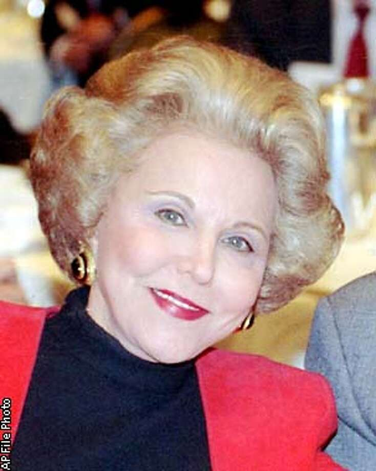 ** FILE ** Ann Landers, is shown in this 1990 photo, location unknown. Landers, the columnist whose snappy, plainspoken and timely advice helped millions of readers deal with everything from birth to death, died Saturday, June 22, 2002. She was 83. (AP Photo/Mark Elias) Photo: MARK ELIAS