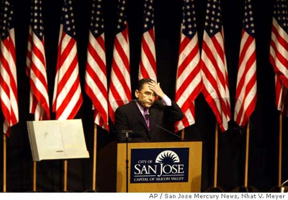 San Jose Mayor Ron Gonzales wipes his brow about five minutes before leaving the stage suddenly during the 2004 State of the City Address at the Center for the Performing Arts in downtown San Jose, Calif., Wednesday, Jan. 28, 2004. Gonzales suffered a minor stroke Wednesday night in the middle of an annual program that assesses the state of the city, the San Jose Fire Department said. (AP Photo/San Jose Mercury News, Nhat V. Meyer) Photo: NHAT V. MEYER