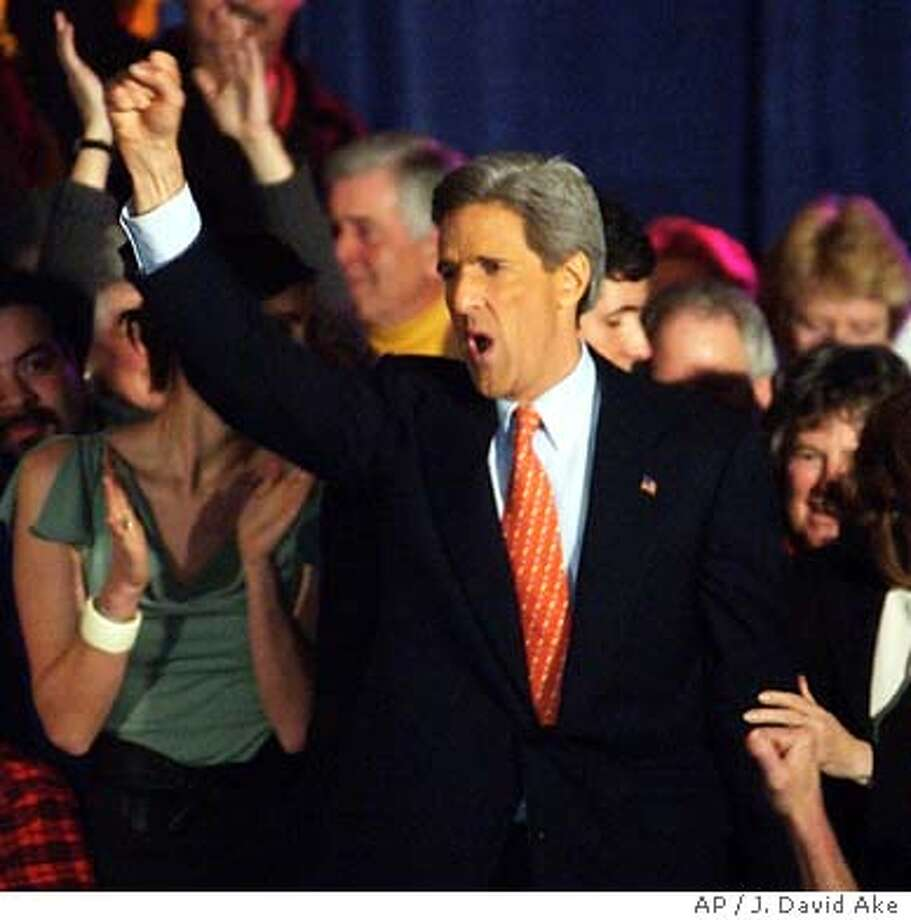 Democratic hopeful Sen. John Kerry, D-Mass, reacts to supporters as he steps on stage at this primary night party in Manchester, NH., Tuesday, Jan. 27, 2004. (AP Photo/J. David Ake) Photo: J. DAVID AKE