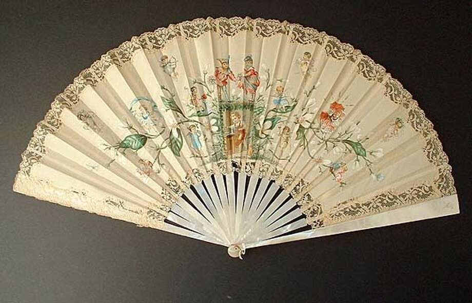 This 1898 English fan�depicts cupids�standing in the branches of an Orange tree�ready to shoot their arrows of love at a maiden, who is hiding�beneath an umbrella. / handout