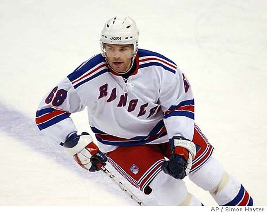 Jaromir Jagr skates during his first New York Rangers start in first-period NHL action on Saturday, Jan.24, 2004, in Ottawa. Jagr was traded to the Rangers on Friday sending in return Anson Carter to the Washington Capitals. (AP Photo/Simon Hayter) Photo: SIMON HAYTER