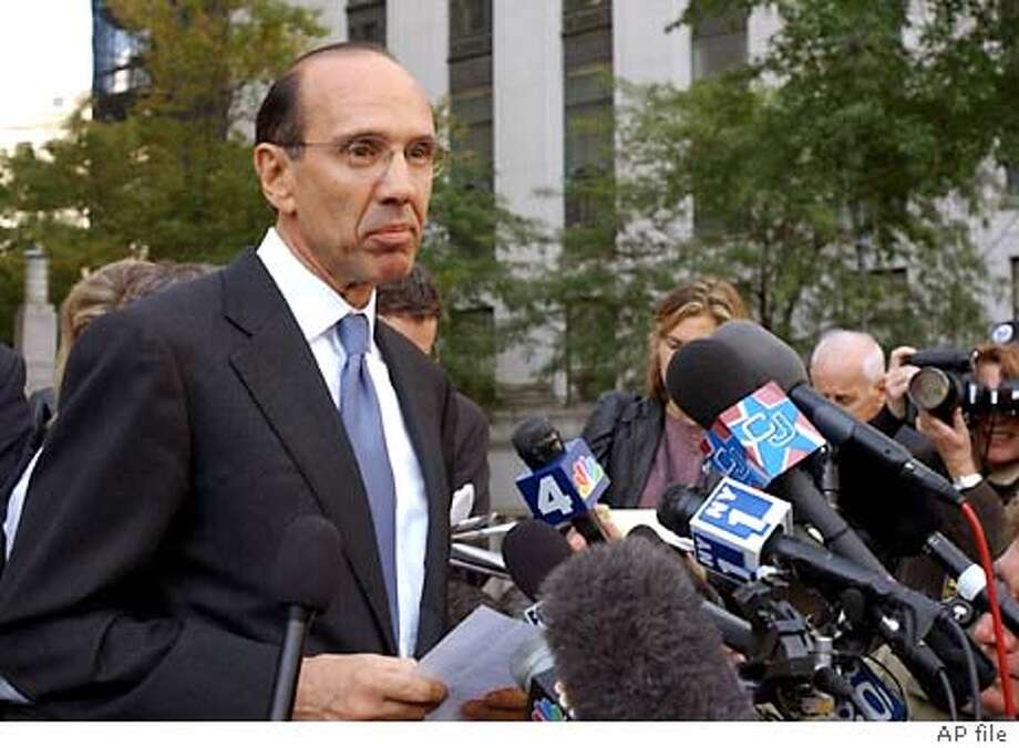 Sam Waksal, founder and former CEO of ImClone Systems, Inc., and a friend of Martha Stewart's, reads a statement outside federal court Tuesday, Oct. 15, 2002, in New York, after pleading guilty to multiple charges in the company's insider trading case. (AP Photo/Louis Lanzano) CAT Photo: LOUIS LANZANO