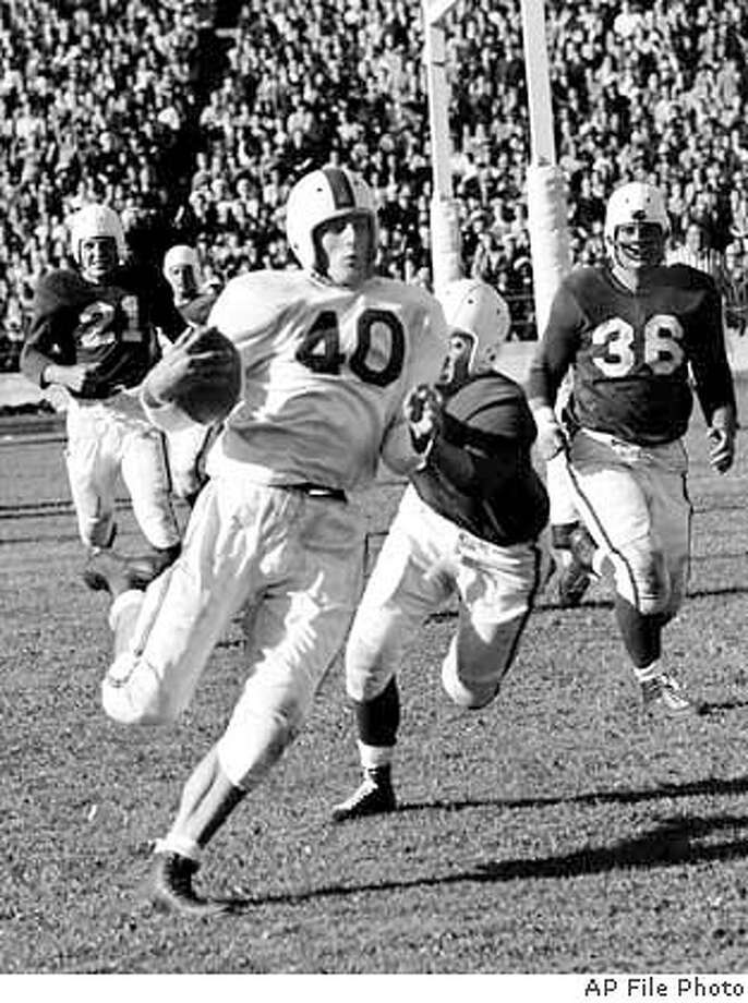 "** FILE ** Chicago Rockets Elroy ""Crazy Legs"" Hirsch (40) scores a touchdown against the 49ers in this Sept. 1, 1946 file photo in San Francisco. Hirsch, an NFL Hall of Famer and later the athletic director at the University of Wisconsin, died early Wednesday, Jan. 28, 2004, of natural causes at an assisted living facility in Madison, Wis. He was 80. He earned his nickname for his running style as a halfback and receiver for the NFL's Los Angeles Rams in the NFL from 1949-57. Before that, he played forthe Chicago Rockets of the All-America Football Conference.(AP Photo) A Sept. 1, 1946 B&W file photo"