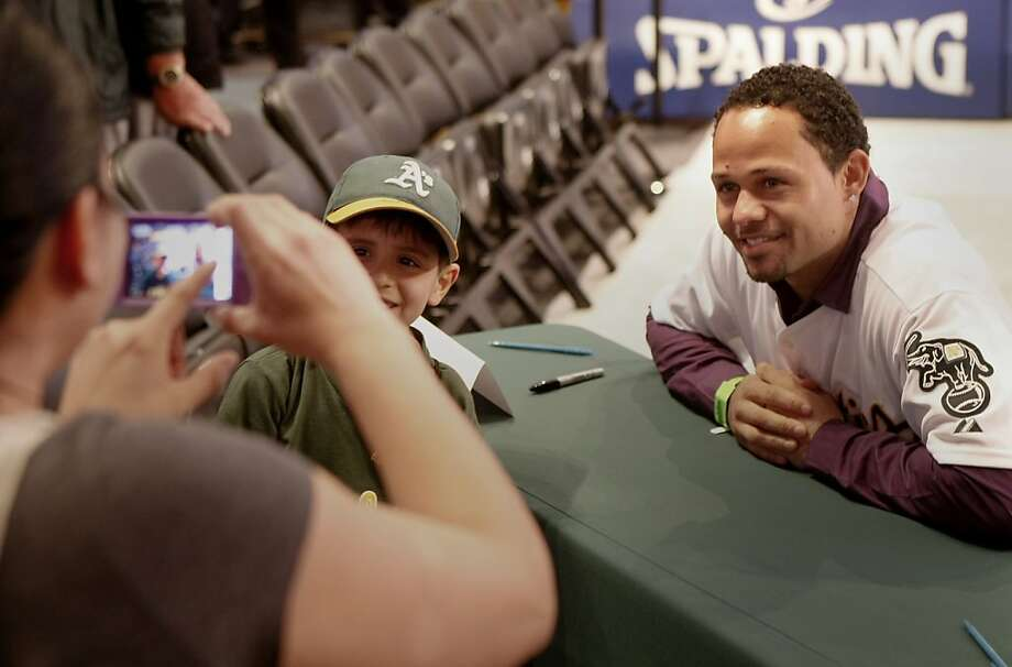 Coco Crisp helped a fan get a memorable picture. The Oakland A's held their annual FanFest at the Oakland Arena Sunday January 29, 2012 to delight of their fans. Photo: Sean Culligan, The Chronicle