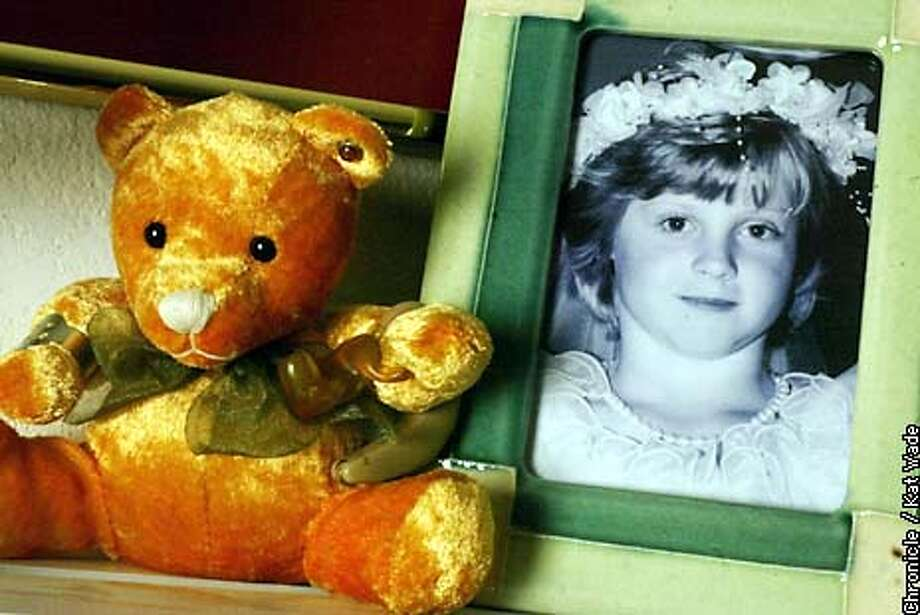 A photograph of Amber Swartz, then 7, on the day of her confirmation is displayed with a small teddybear at her mother, Kim Swartz' home. Amber disappeared while jump roping outside her Pinole home almost 14 years ago. SAN FRANCISCO CHRONICLE PHOTO BY KAT WADE Photo: KAT WADE
