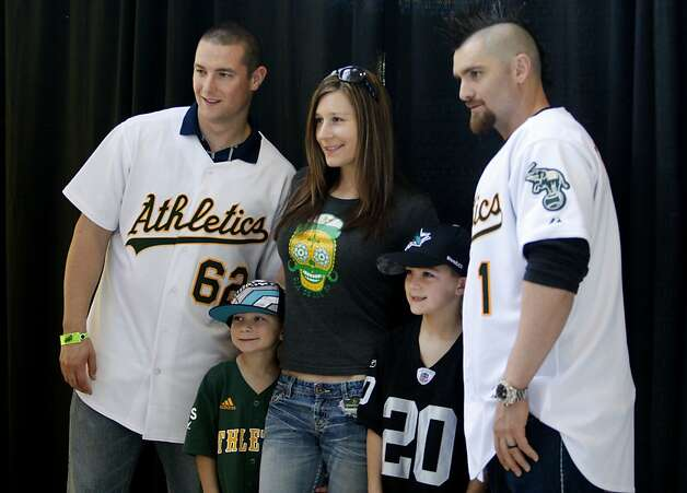 The newest Oakland Athletic Jonny Gomes (right) posed with some fans at the event. Pitcher Neil Wagner is on left. The Oakland A's held their annual FanFest at the Oakland Arena Sunday January 29, 2012 to delight of their fans. Photo: Sean Culligan, The Chronicle