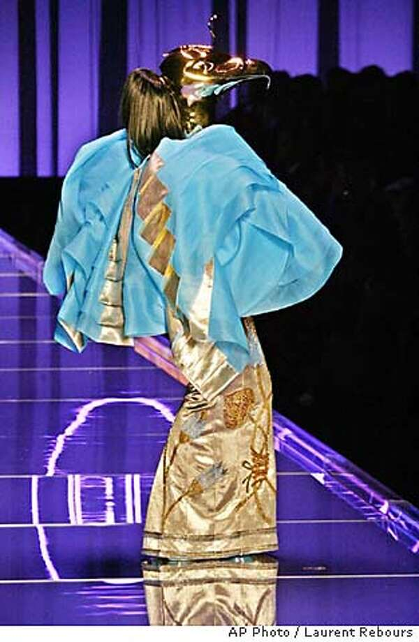 A model presents an embroidered silk and tulle ensemble inspired by Egypt divinity Horus, and designed by British fashion designer John Galliano for Dior's Spring Summer 2004 haute couture fashion collection presented Monday, Jan. 19, 2004 in Paris. (AP Photo / Laurent Rebours) Photo: LAURENT REBOURS