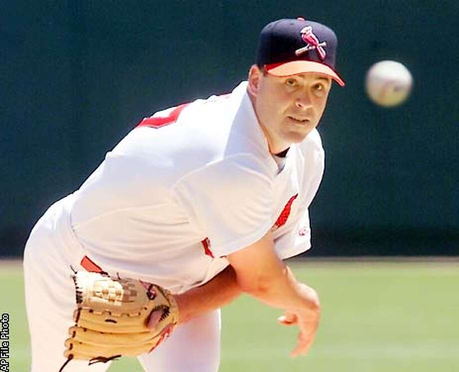 ** FILE ** St. Louis Cardinals pitcher Darryl Kile throws against the Atlanta Braves in May 2002 in St. Louis. Kile was found dead in his Chicago hotel room Saturday, June 22. He was 33. (AP Photo/Tom Gannam, File) Photo: TOM GANNAM