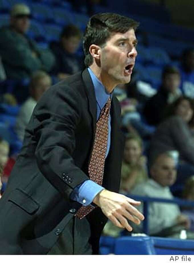 Air Force men's basketball head coach Joe Scott shouts instructions to his players during a game against Arkansas-Pine Bluff at Clune Arena Saturday, Nov. 22, 2003. The Falcons won the game 63-40. Behind a patient offense and the nation's stingiest defense, the Falcons are on a school-record 10-game winning streak and a surprising 12-2 overall, the best start in Air Force history. (AP Photo/The Gazette, David Bitton) Photo: DAVID BITTON