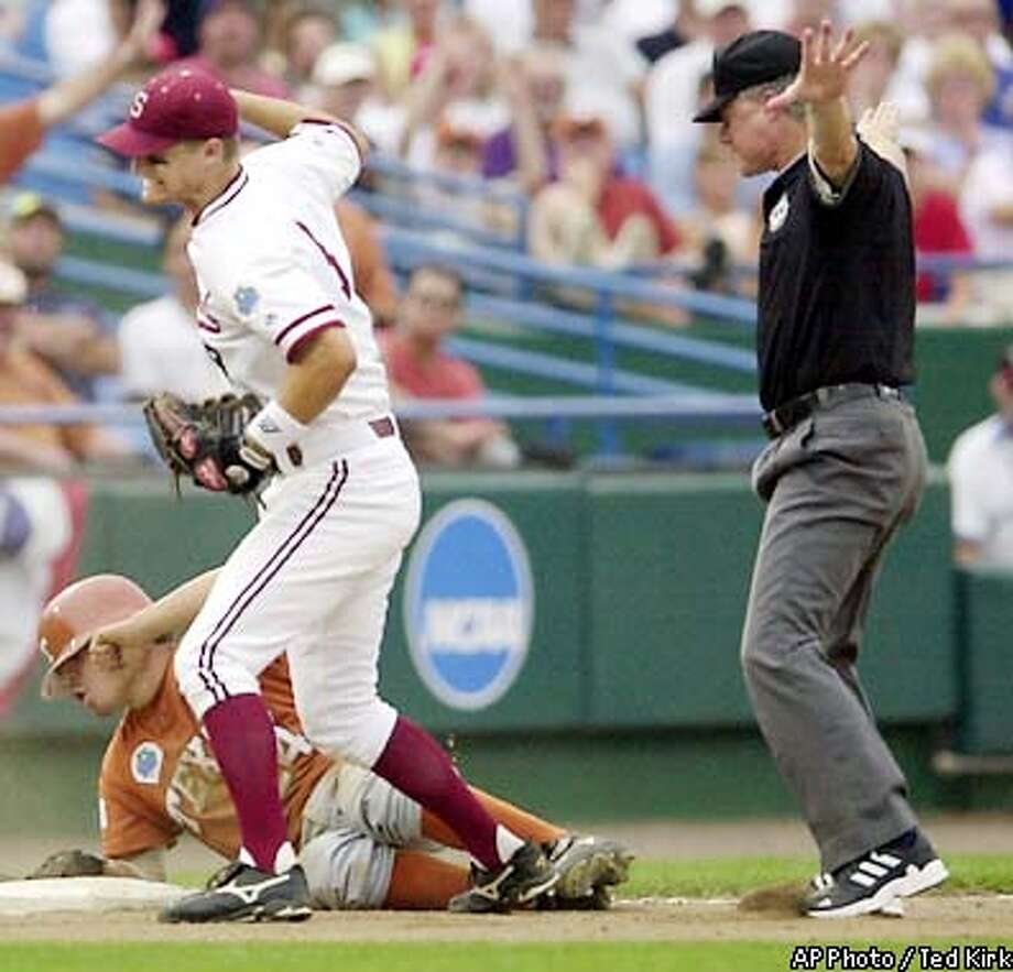 Stanford third baseman Scott Dragicevich reacts to third base umpire Jim Garman's ruling that Texas' Omar Quintanilla (24) is safe with a triple in the fifth inning of a College World Series game Thursday, June 20, 2002, in Omaha, Neb. (AP Photo/Ted Kirk) Photo: TED KIRK