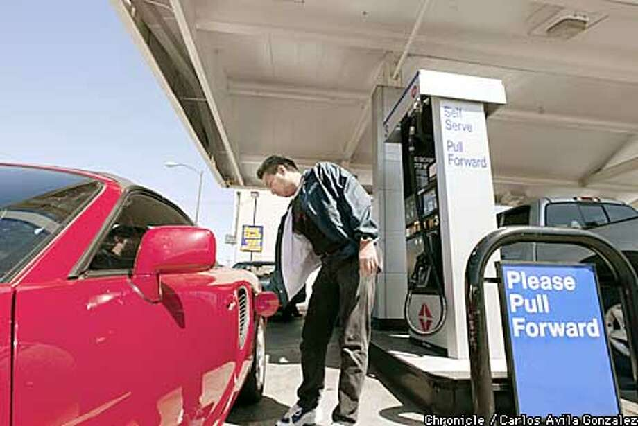 Tony Carpio pumps gas at the ARCO gas station on Geneva Avenue in San Francisco, which was one of three in the city which had failed to comply with changing underground storage tanks.  (CARLOS AVILA GONZALEZ/SAN FRANCISCO CHRONICLE) Photo: CARLOS AVILA GONZALEZ