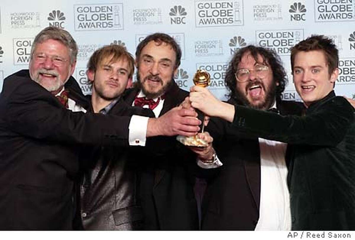 Director Peter Jackson, second from left, poses with the cast and crew of �The Lord of the Rings: The Return of the King,� at the 61st Annual Golden Globe Awards in Beverly Hills, Calif. Sunday, Jan. 25, 2004. Jackson won the award for best director. (AP Photo/Reed Saxon)