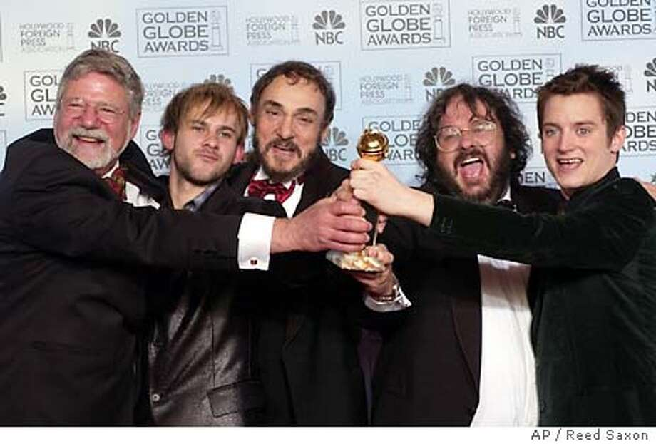 Director Peter Jackson, second from left, poses with the cast and crew of �The Lord of the Rings: The Return of the King,� at the 61st Annual Golden Globe Awards in Beverly Hills, Calif. Sunday, Jan. 25, 2004. Jackson won the award for best director. (AP Photo/Reed Saxon) Photo: REED SAXON