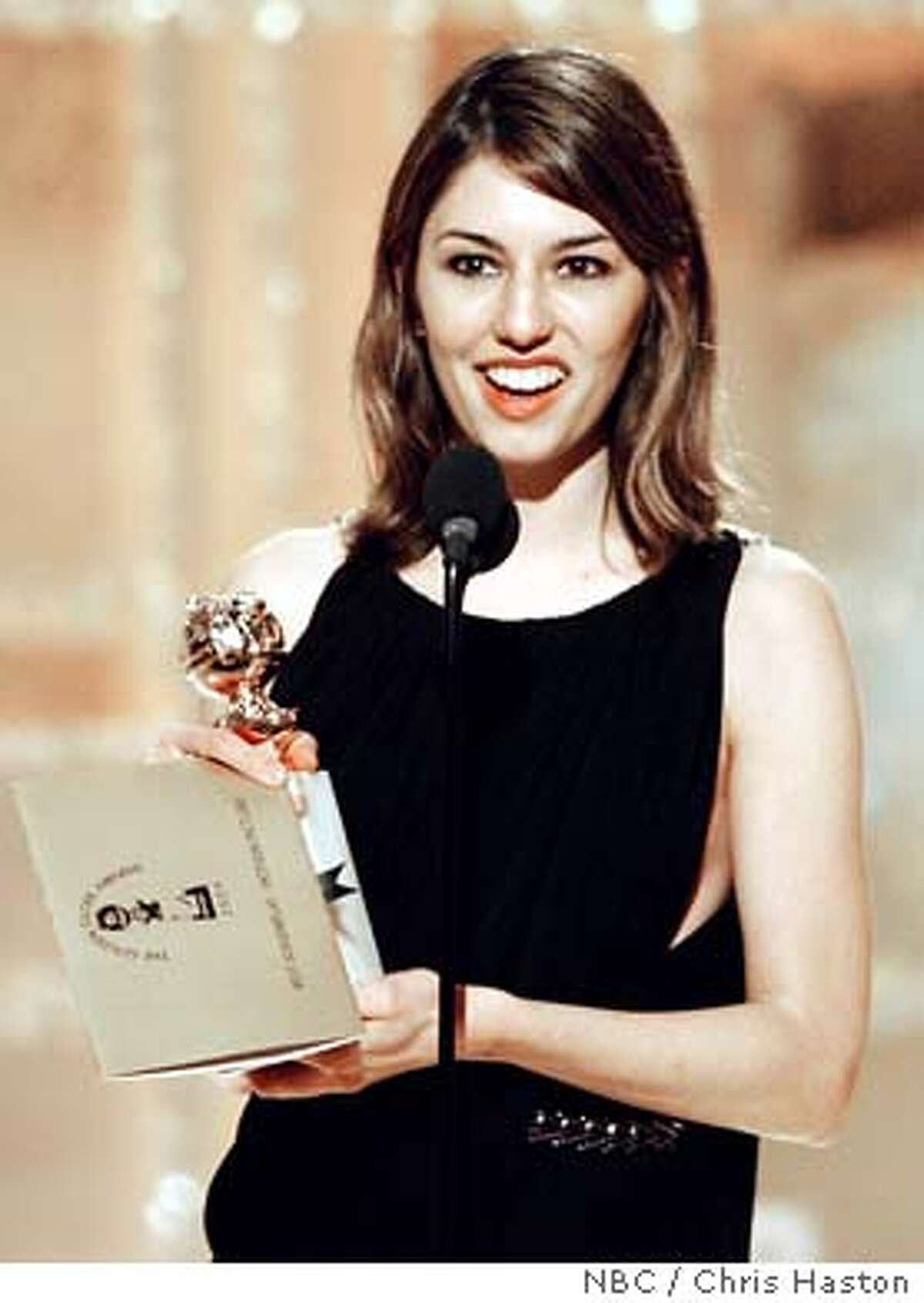 Director Sophia Coppola holds her award after winning Best Screenplay for a motion picture for her wok on the film