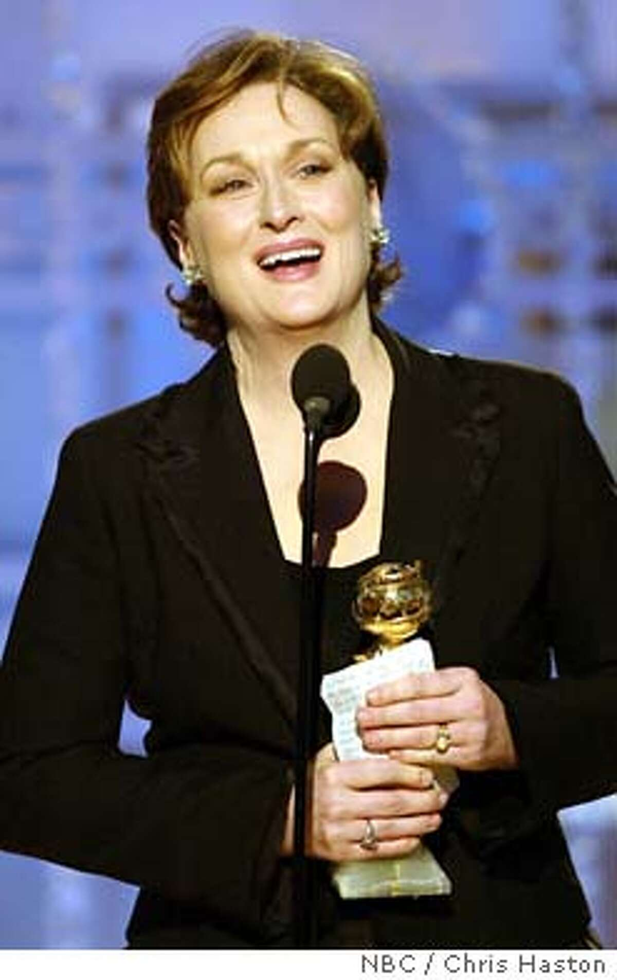 Actress Meryl Streep holds her award after winning best actress in a mini-series or television movie during the 61st annual Golden Globe Awards in Beverly Hills January 25, 2004. MANDATORY CREDIT FOR EDITORIAL USE ONLY NBC / Chris Haston/NBC/Handout ONLINE/INTERNET USE OF THIS IMAGE FROM THE GOLDEN GLOBES AWARDS SHOW EMBARGOED AND RESTRICTED FROM USAGE UNTIL THE CONCLUSION OF THE SHOW UNTIL APPROXIMATELY 2300 EDT/0400 GMT PER HOLLYWOOD FOREIGN PRESS ASSOCIATION