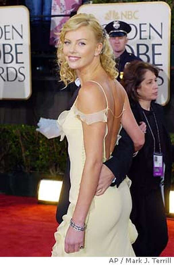 Charlize Theron arrives for the 61st Annual Golden Globe Awards on Sunday, Jan. 25, 2004, in Beverly Hills, Calif. (AP Photo/Mark J. Terrill) Photo: MARK J. TERRILL